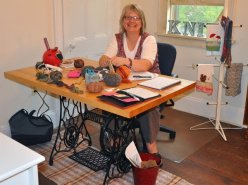 Studio Artist Laurine Gilbert, gives knitting lessons in the studio