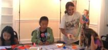 Origami teacherJoy Ann Cabaro with students  Samantha Lee, Cynthia Chen and Allie deAsla
